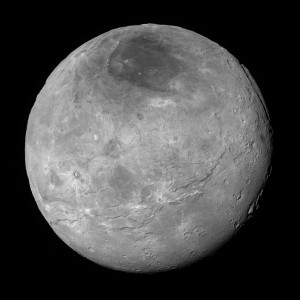 Największy naturalny satelita Plutona, Charon.