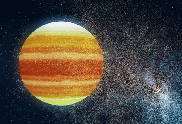 Planeta (kula) w otoczeniu pulsara (w prawym dolnym rogu). Grafika: Uniwersytet w Cambridge.